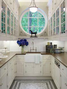 pantry, round window, pendant lighting, glass cabinets