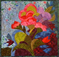 June Blooms art quilt, 15.5 x 16″, by Karen Gillis Taylor.