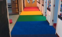 Supacord carpet has been used to create a stunning rainbow corridor in Padstow School.