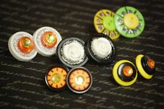 If you love Halloween and earrings, then the Halloween Button Earrings are for you. Even if you've never made DIY jewelry before, this is a great Halloween craft for you.