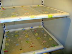 Line fridge shelves with Saran Wrap's Press and Seal paper, then peel off and replace when dirty. Geeeeenius.