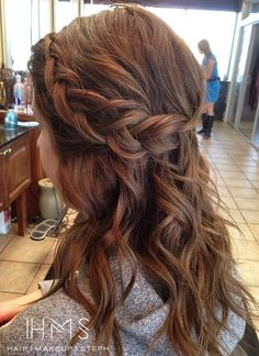 Half up braided curls.