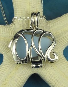 Sea Glass Necklace Elephant Locket Baby Blue Milk Glass.#Repin By:Pinterest++ for iPad#