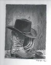 Cowboy hat and boots and lasso tattoo