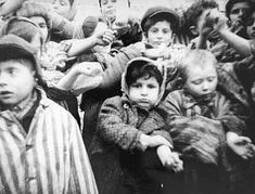 These children at Auschwitz, liberated by the Soviet Army on January 27, 1945, show their tattooed arms to the photographer. Everyone imprisoned in Auschwitz had his or her arm tattooed with an identification number. This served two purposes. First, it allowed camp officials to keep track of the thousands of prisoners in the camp. Second, making the inmates into nameless units served to dehumanize them