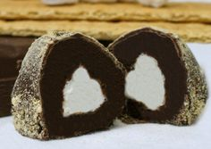 S'mores Truffles ~~  These are incrediblyDe-lic-ious!  Consisting of a chocolate shellrolled in graham cracker crumbs, witha melt-in-your-mouthfudge beneath that,all hugging the marshmallow center!