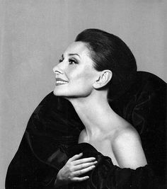 Audrey wearing Valentino, is photographed by Avedon for a Revlon ad, 1987