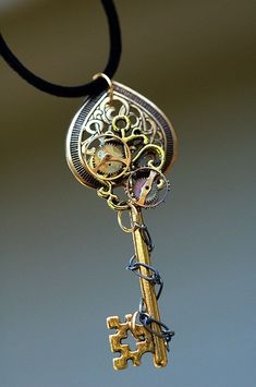 Golden Celtic Heart Gears Key Necklace - This Would Look Cool As Part Of A Tattoo-- Golden Celtic Heart Gears Key Necklace.