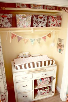 I love how the closet space is utilized for the changing table...Super cute table too!