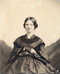 Pregnant woman in late Victorian era.  Pregnancy was considered in illness.  She is pregnant and smiling for the camera, two rarities.