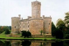 """""""How could anyone describe this as cozy?"""" I asked when we arrived at the house outside Limousin. Les Revenants was smaller than Sept-Tours, but not by much. There were only four towers, Matthew pointed out, one on each corner of the square keep. But the moat that surrounded it was large enough to qualify as a lake...""""  There is a similiar home for sale here: http://www.my-french-house.com/property-in-france/limousin/chateau/60755/"""