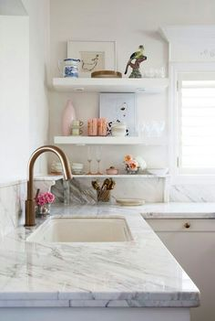love the additional little Marble shelf to the all Marble counter tops