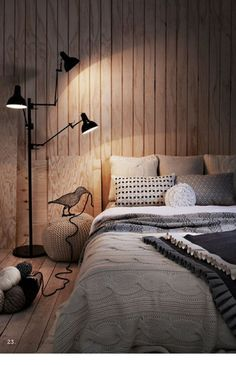 Het leuke aan deze slaapkamer is dat de houten vloer overloopt in ...