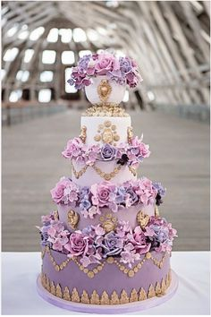 A terrifically beautiful Marie Antoinette inspired purple and gold cake. #wedding #cakes #purple