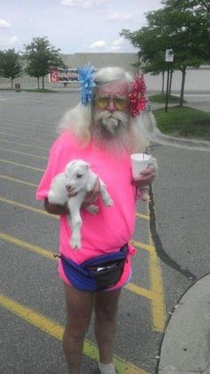 .man with baby goat