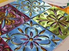 Faux Tin Tiles made from disposable cookie sheets from the dollar store.