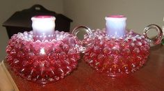 Pair of Fenton Cranberry Opalescent Hobnail Candleholders