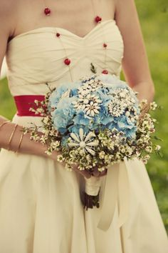 love mix of brooches with fresh florals