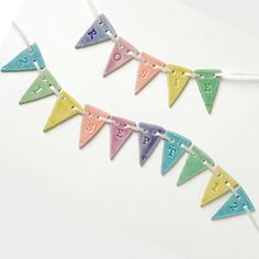 Celebrate a new arrival with a keepsake custom porcelain bunting.