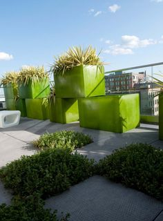 Could do this with repurposed file cabinets, to block the back fence/dogs.>>> Stacked planters on roof terrace