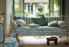 A wrought-iron day bed, use it indoors!