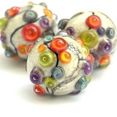 Autumn Ball - Round Lampwork Glass Bead Set in Bright Fall Colors (3). $42.00, via Etsy. sarahhornik