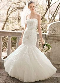 Strapless tulle gown featuresallover-beaded layered lace and sweetheart neckline.  Fit and flare shape