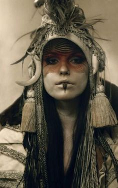 I love this old world vintage/tribal thing going on.....with the facepaint! <3 it!