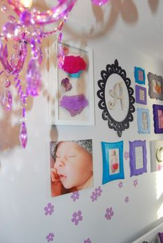 This is a stunning gallery wall for a pink, yellow, gray, and purple #nursery.  #gallerywall #frames #initial