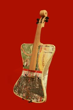 A viola made from a tin paint container, recycled wood and a fork made by two guys from Paraguay on display at Phoenix's Musical Instrument Museum (MIM)