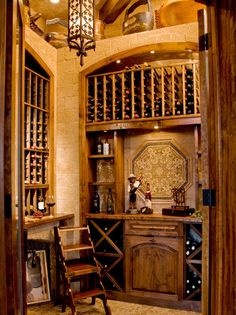 Designer Cindy Aplanalp transformed a small walk-in closet and former office into a stylish Old World wine grotto.