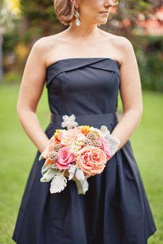 black bridesmaids dress with pastel bouquet.