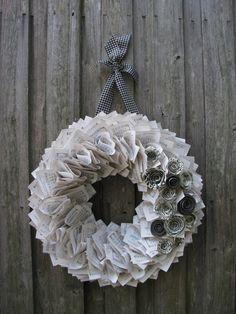 Vintage Hymnal Wreath with Black & White Rosettes.45.00, via Etsy.