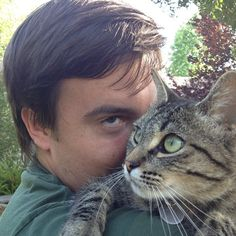 Ryan loving the kitty - @carlyathorne- Ryan our Amazing Editor and Camera God LOL... On location loving Kitties...
