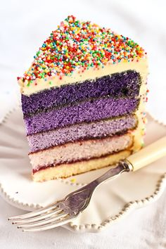 Purple ombre cake with sprinkles. Too cool!