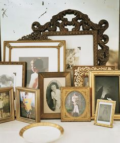 love the potpourri of frames (with family pictures of all eras)