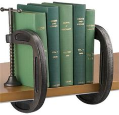 "Tool Man Bookends.  ""I love tools, I love vintage & and I love books so to me these Grip Book Ends (hand cast industrial tool clamps repurposed as bookends) are just the best idea! I will have some for my own bookshelves just as soon as I can get my hands on some nice vintage clamps."""