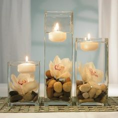 Pebble, flower, floating candle center pieces.