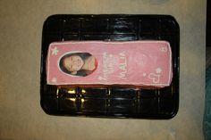 For my daughter's American Girl birthday party, I turned her into a doll!  Her cake is an American Girl box featuring her picture as the doll face showing through.  This is a 9x13 cake cut lengthwise & stacked.  I printed the photo on a laser printer and placed an exact shape of wax paper underneath.