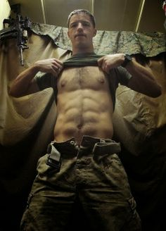 Soldier showing abs ;)