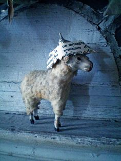 Give your old putz sheep a paper hat :)