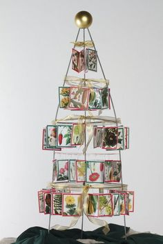 tomato cage tree repurpos idea, cage tree, tomato cage, christma tee, seed packet, garden friend, christma craft, gift idea, garden christma