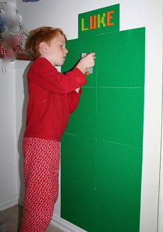 Homemade Lego Wall. Instead of just putting on the wall, place a large frame around it (some rectangle, some circle) so it displays like changing art on the wall.