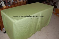 made a custom table cover for craft fairs out of sheets there is a tutorial on my blog