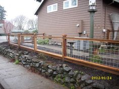 "Galvanized wire with wood frame fence or ""Hog Panel"" fencing"