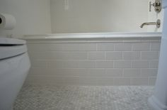 One Story Building: Kohler Archer Drop-In Tub with Daltile subway tiles and white carrara marble hex tiles ...
