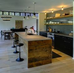 vintage  beach house pictures | love the vintage industrial treatment of the kitchen - reclaimed ...