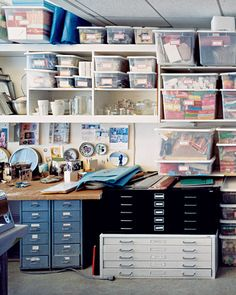 Bins of frabrics, papers and tools make up the craft room.