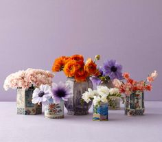 Tea canisters make elegant vessels for holding just about any bloom.