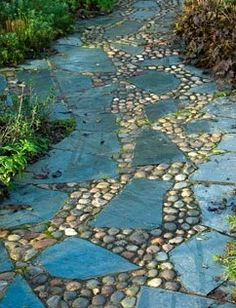 Path of slate and sea washed pebbles in the West Country Town Garden